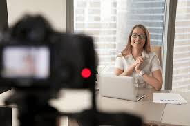 A corporate woman being recorded on camera for an interview