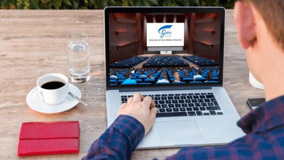 A man watching a webinar during a virtual trade show