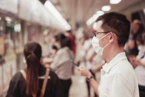 man wearing mask in commute