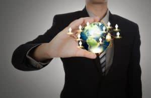 A person holding a virtual globe