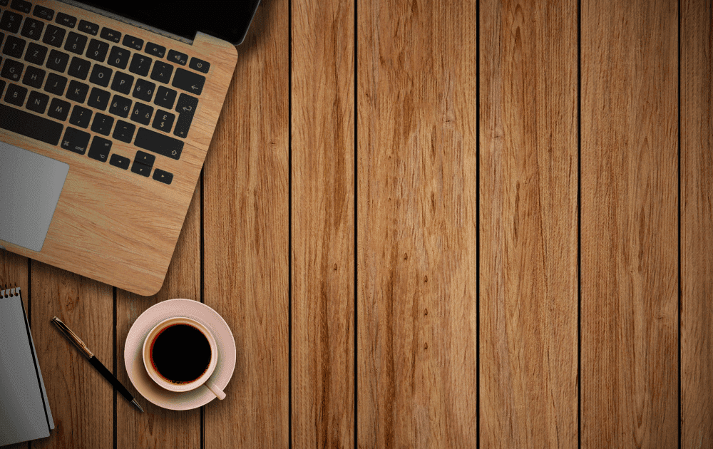 Coffee and a laptop on a table