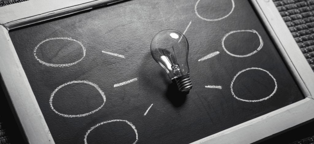 idea board with lightbulb at center