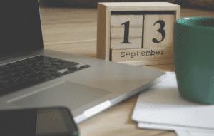 Desk calendar and laptop
