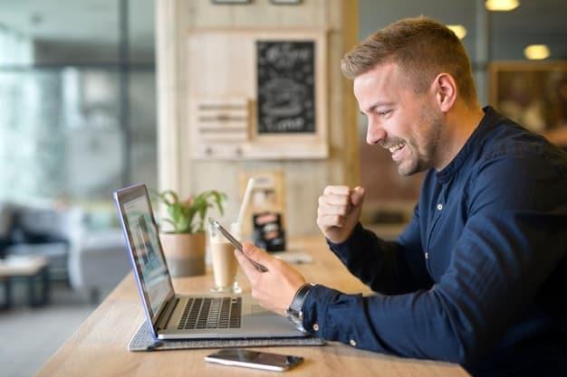 man attending virtual education fair through laptop