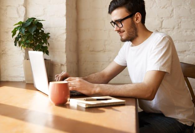 man typing on laptop attending virtual education fair