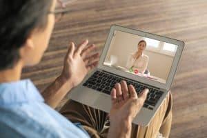 man having a video call with potential employer on a virtual job fair platform