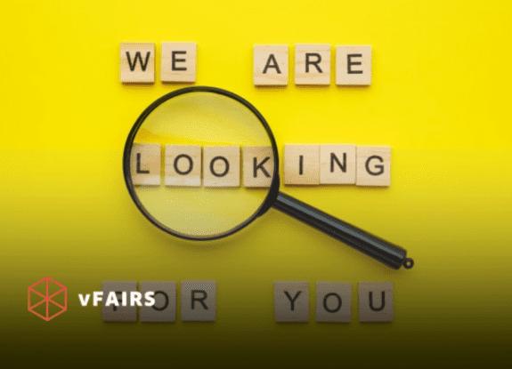 magnifying glass over letter blocks for virtual career fair